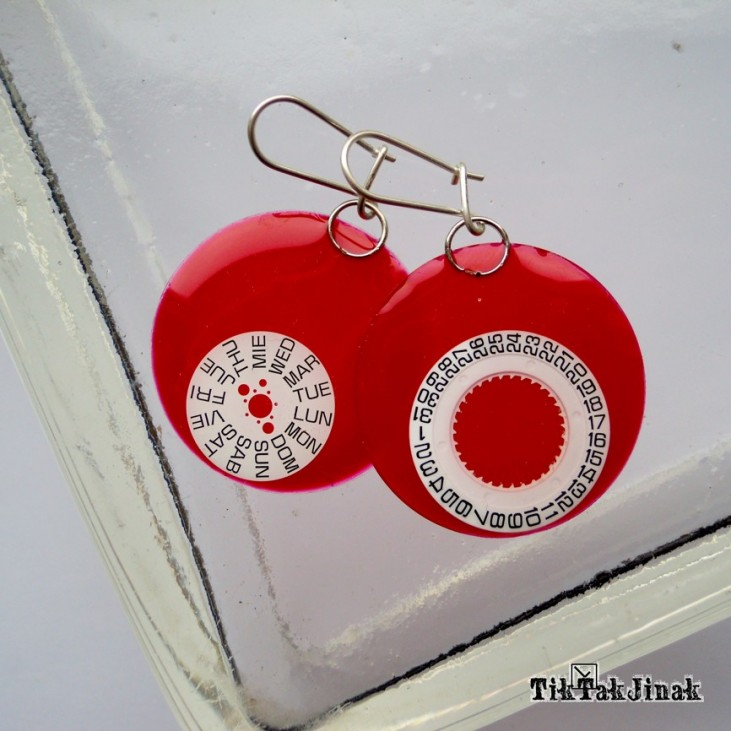 TikkaakJinak-earrings from the clock face