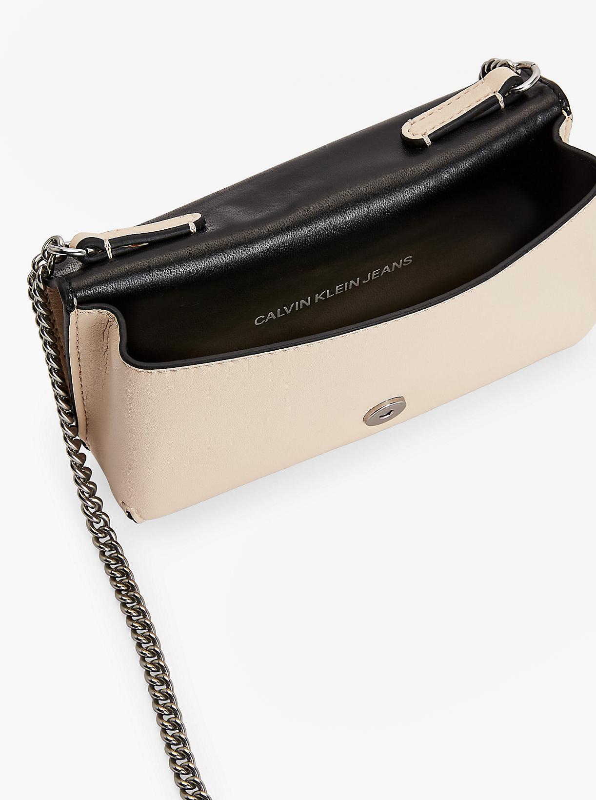 Calvin Klein cream / cream crossbody handbag