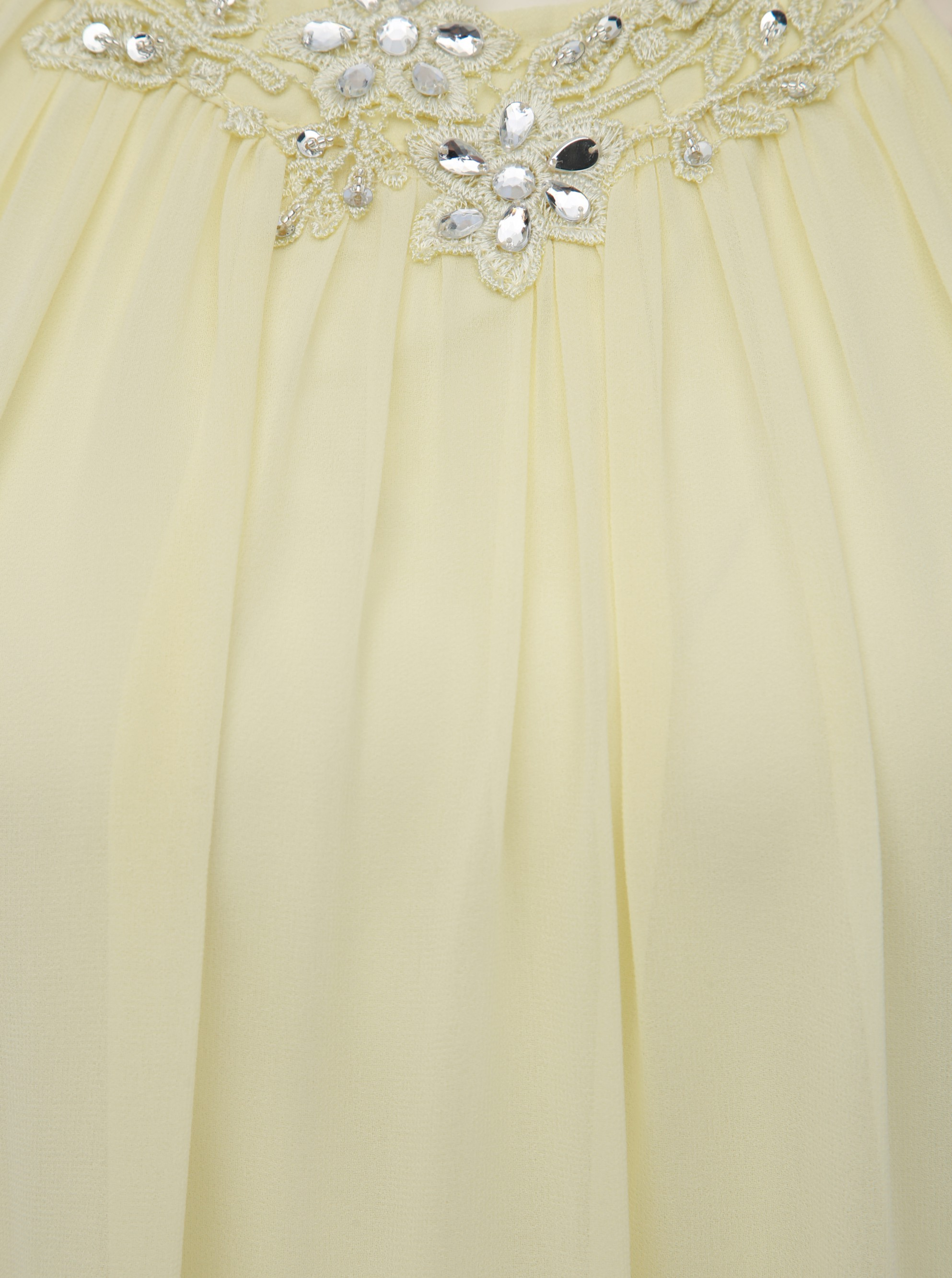 Light yellow dress with a decorative hem by Dorothy Perkins