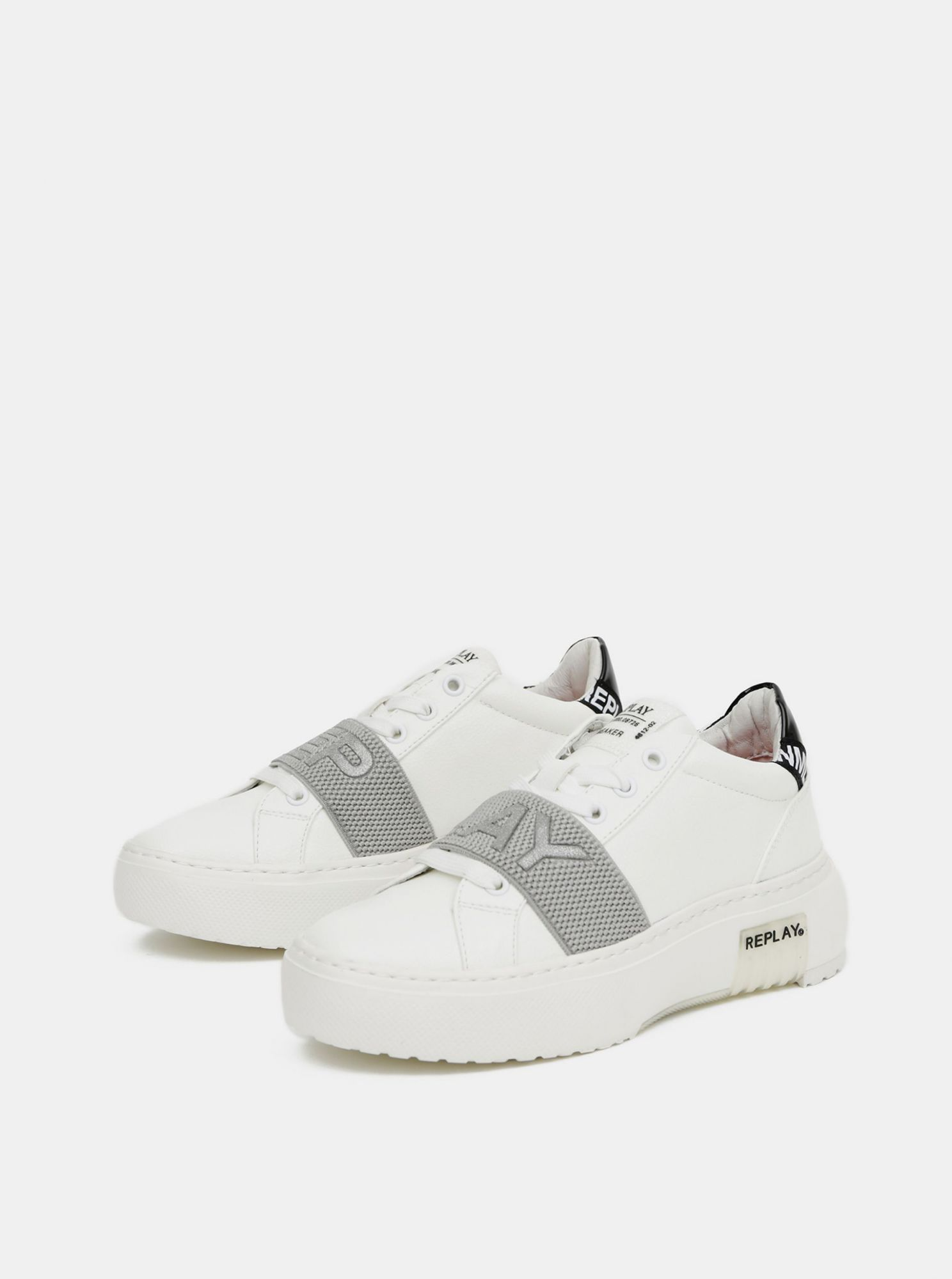 White women\u0026#39;s sneakers on the