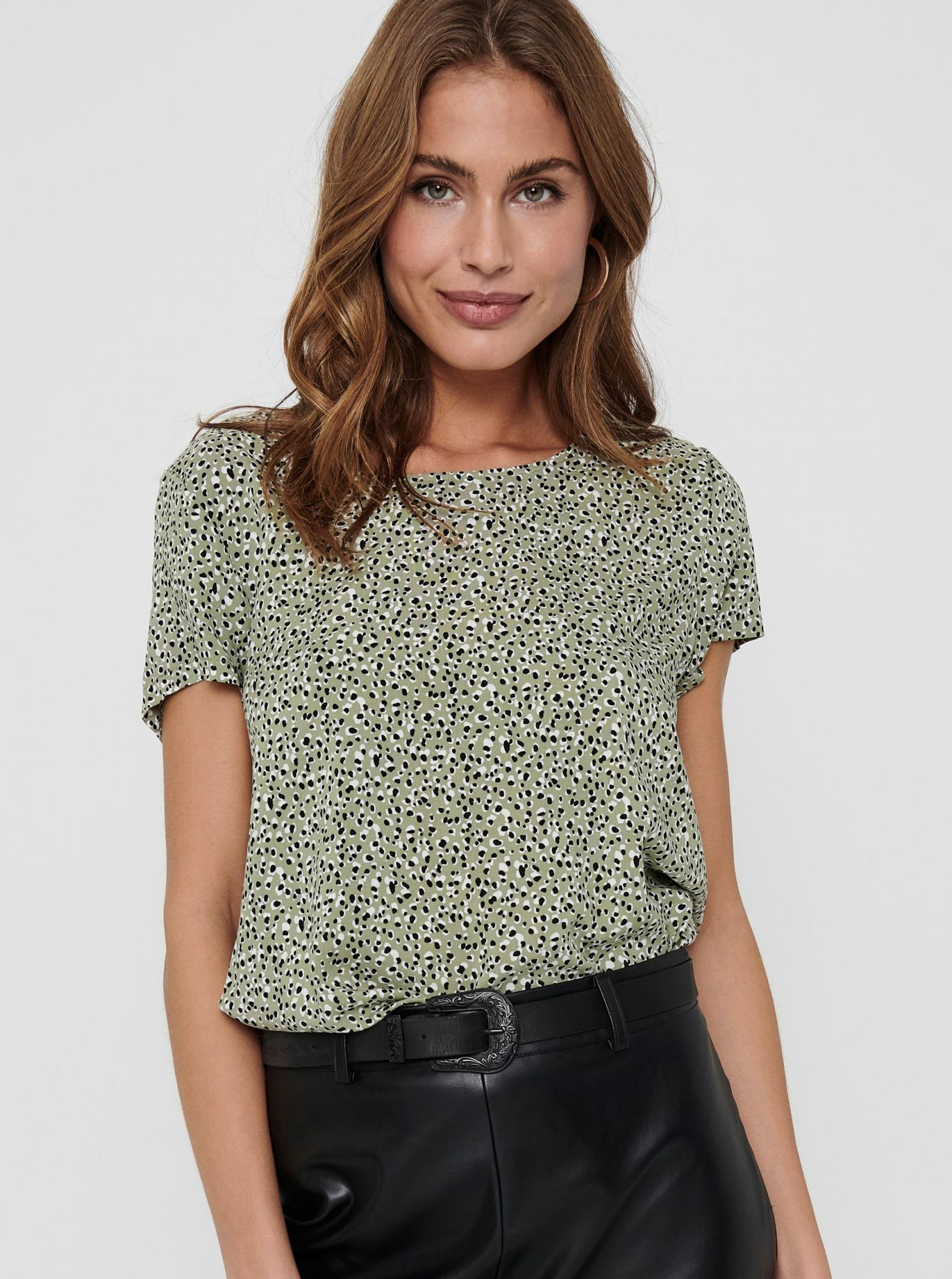 Only green women´s blouse with pattern